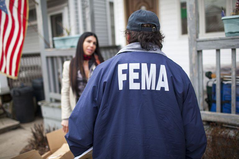 A FEMA agent helping a female victim of Hurricane Sandy