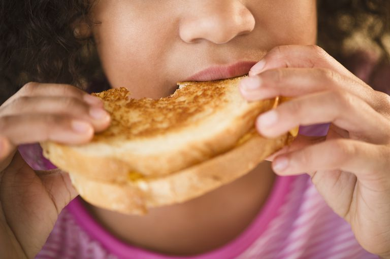 girl-eating-a-grilled-cheese-sandwich.jpg