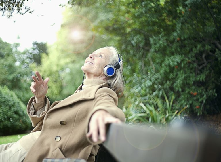 Older woman listening to headphones