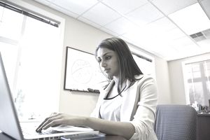 Businesswoman working on computer in office.