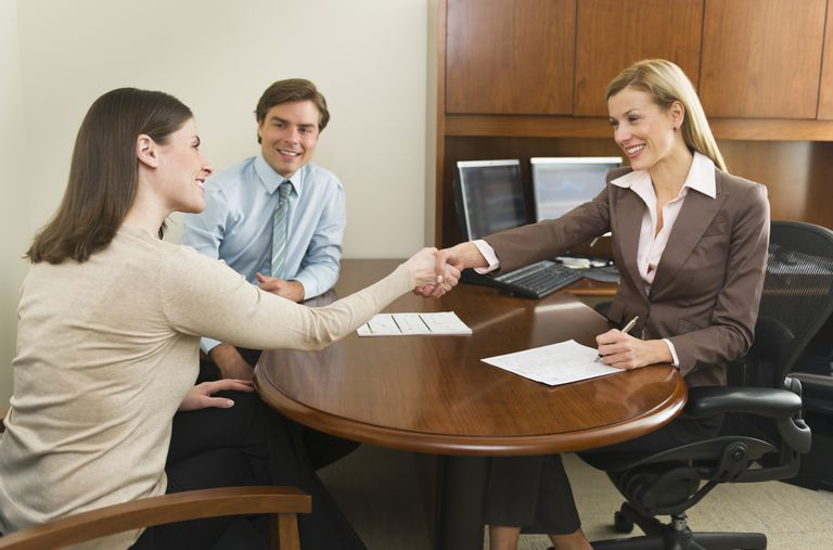 Prepare for a career in Human Resources by taking these steps. A man and a woman interview a woman.