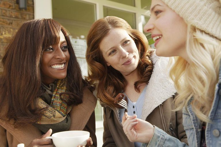 Women having coffee outdoors together