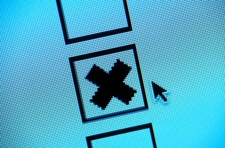 Cursor over 'checked' checkbox on computer screen, close-up