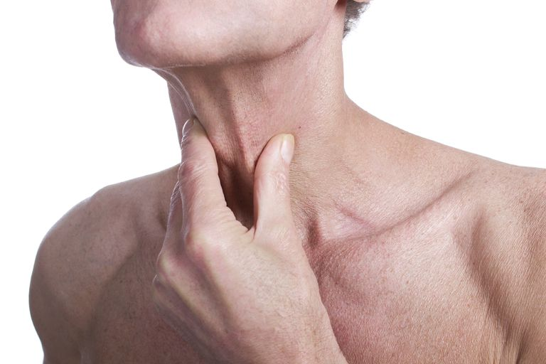 man holding his neck as if having difficulty breathing