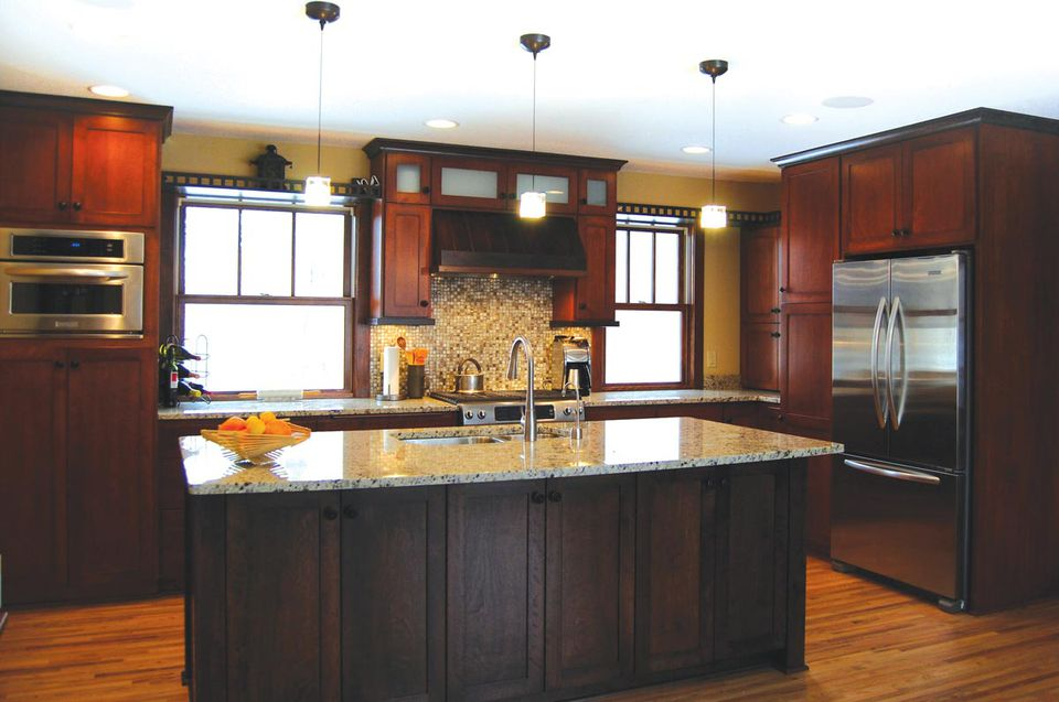 modern kitchen with cabinets and granite countertops