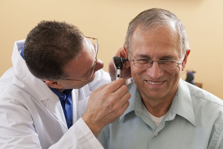 ENT doing an ear canal inspection