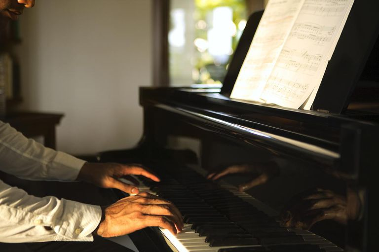 Ethnic man playing piano
