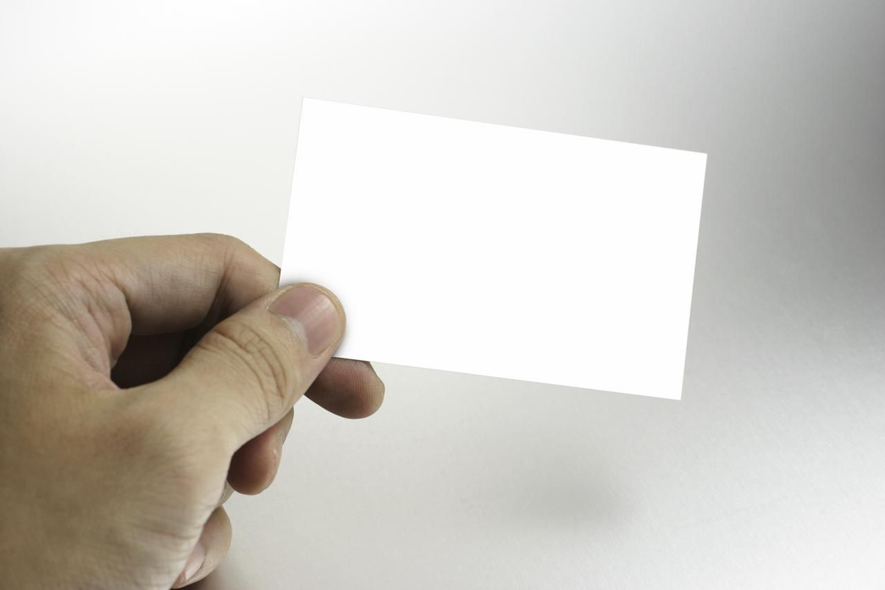 Arts and crafts guide hand holding business card magicingreecefo Image collections