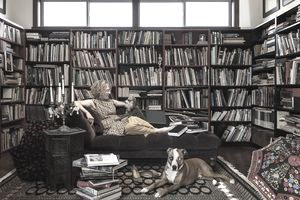 Woman with dogs in library