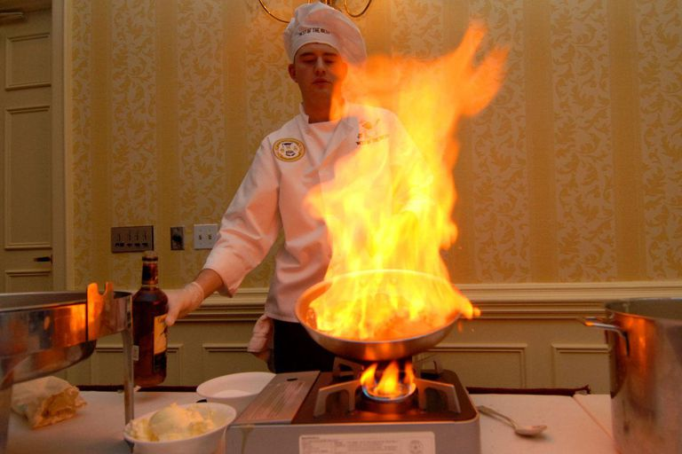 Navy chef takes part in culinary competition. VIRGINIA BEACH, Va. (Feb. 11, 2011) Culinary Specialist 2nd Class Tad Pooler, assigned to Commander, Submarine Forces, prepares strawberries flambe as his dessert entry during the Best of the Mess Challenge competition at the Virginia Beach Sheraton Oceanfront hotel. The Commander, Submarine Force Atlantic culinary team competed against four other commands showcasing their culinary specialties.