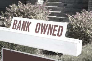 bank owned sign in front of home