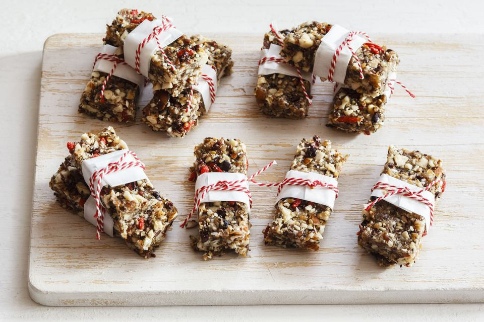 Homemade gluten free granola bars on wooden board