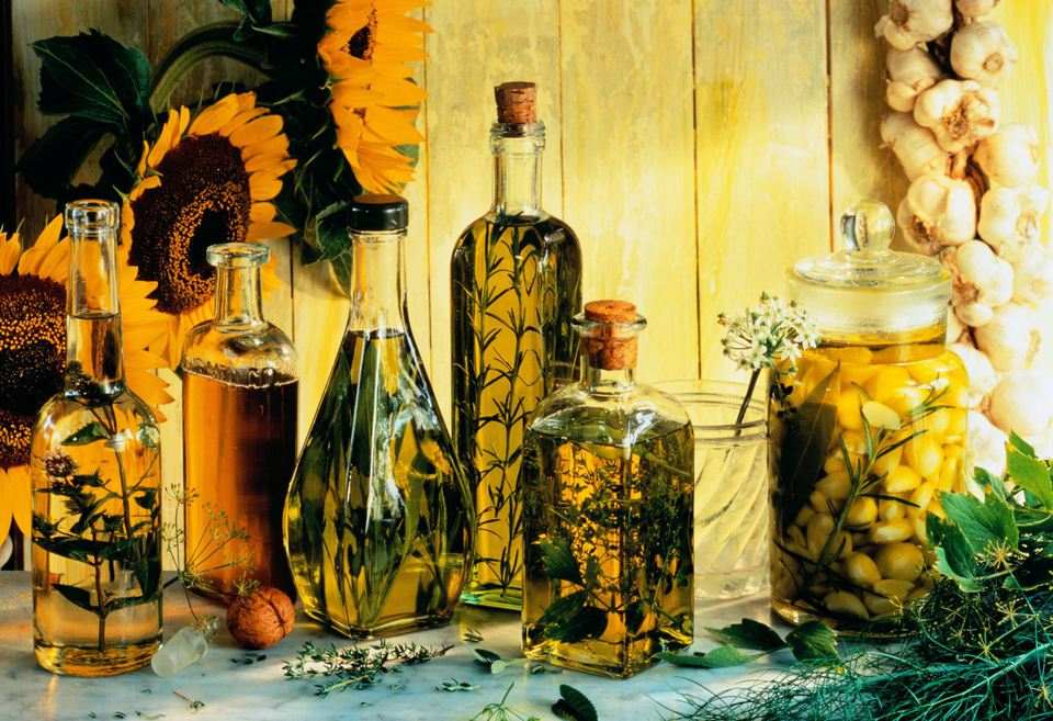 Glass bottles containing various cooking oils flavoured with herbs