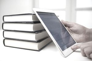 ereader against stack of books
