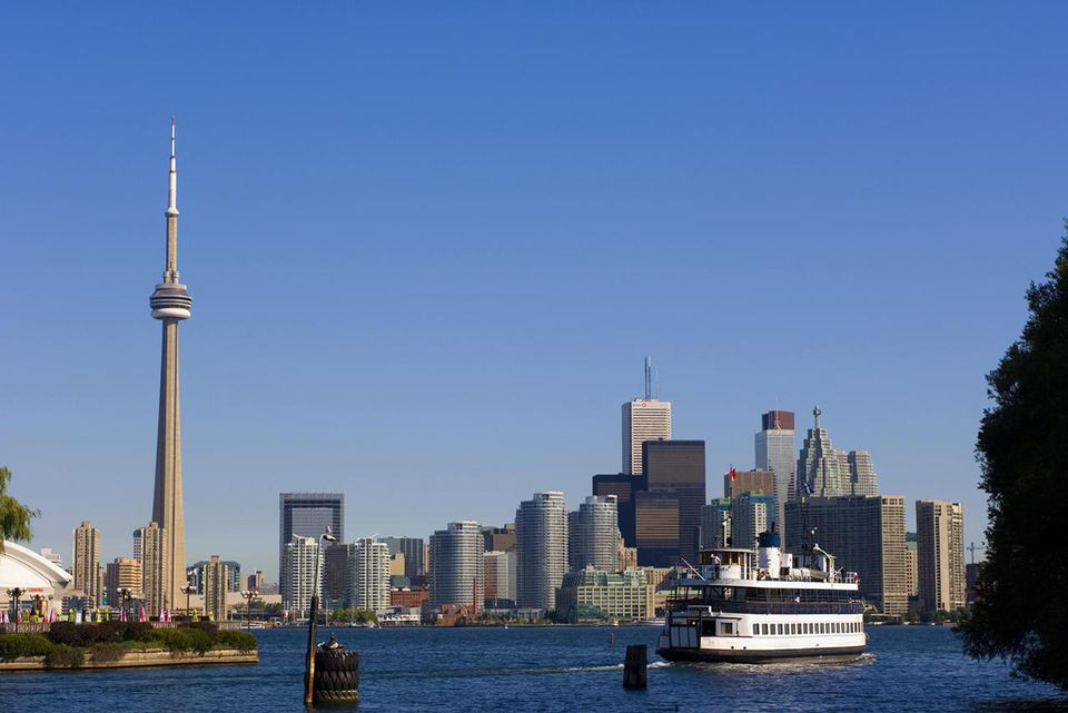 Skyline view and Ferry from across Lake Ontario from Toronto Islands of Toronto, Ontario, Canada