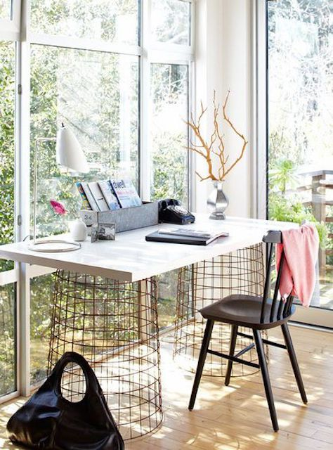Light filled home office surrounded by windows