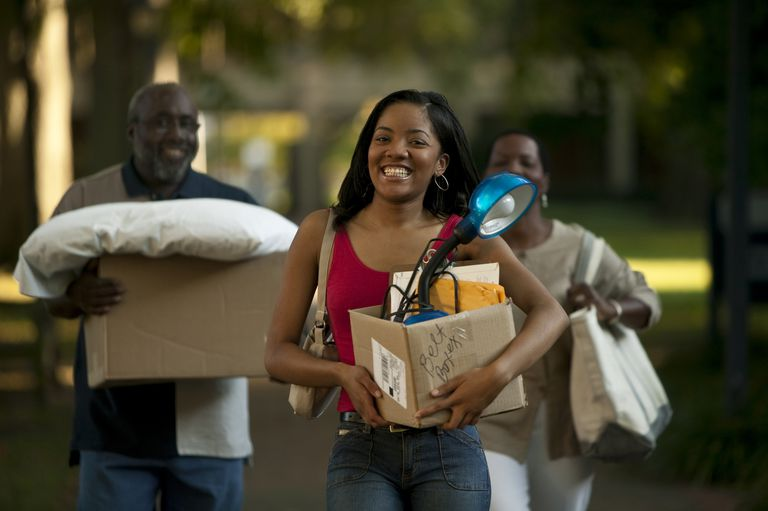 Young woman moving in to Dorm