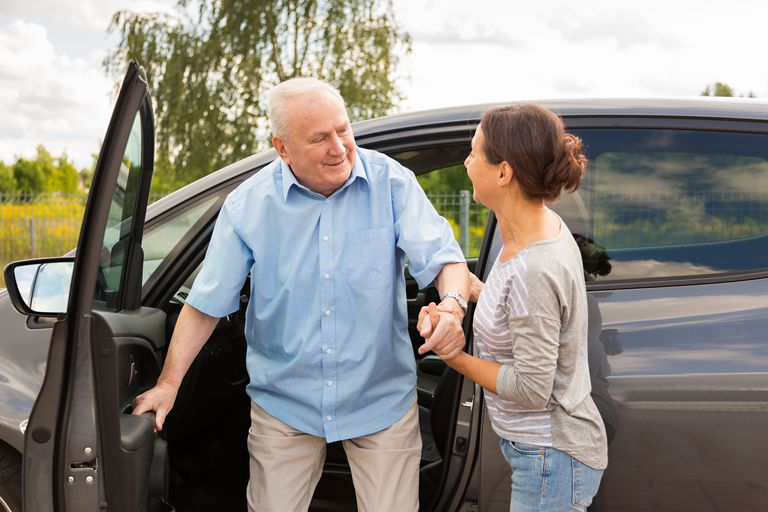 Older man getting out of car