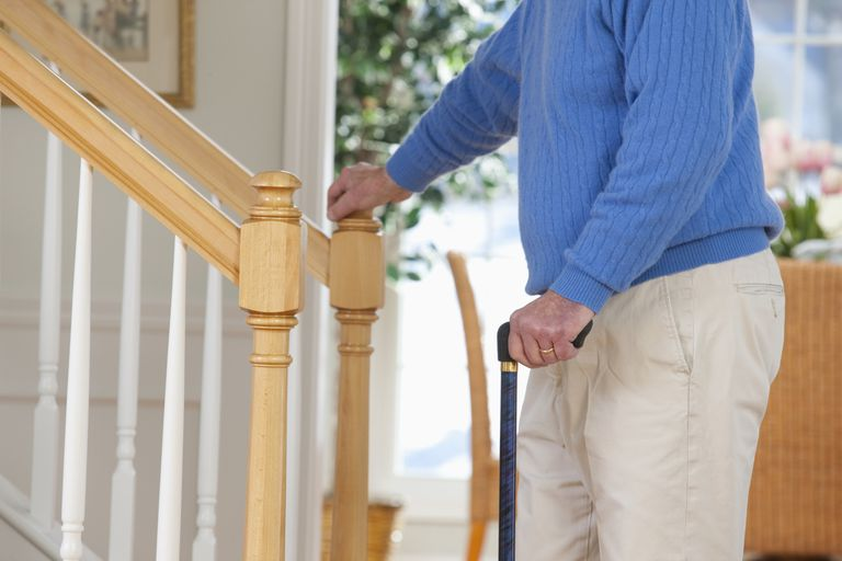 Man suffering from primary progressive multiple sclerosis standing near steps