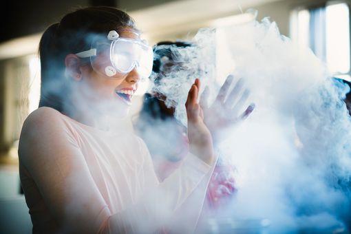 Girl enjoying chemistry experiment