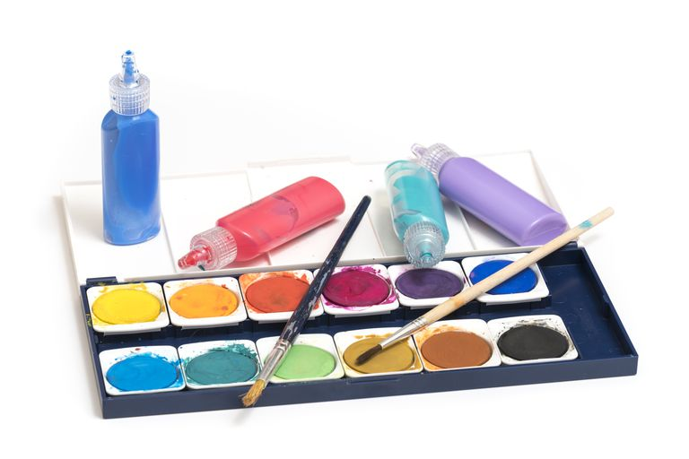 Watercolor paints and paint brushes isolated on a white background