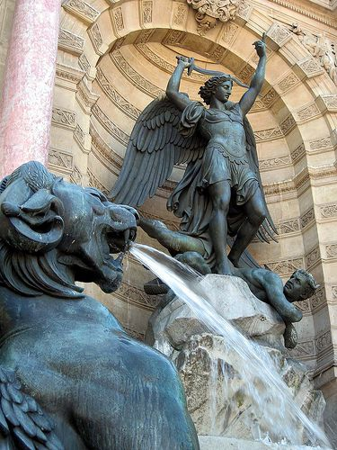 The fountain on the place St-Michel depicts St. Michael slaying a dra