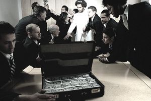 A photo of people in a conference room, fighting over money.