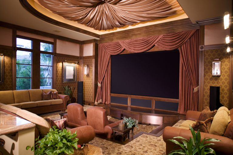 A living room designed with the look and feel of a plush movie theater