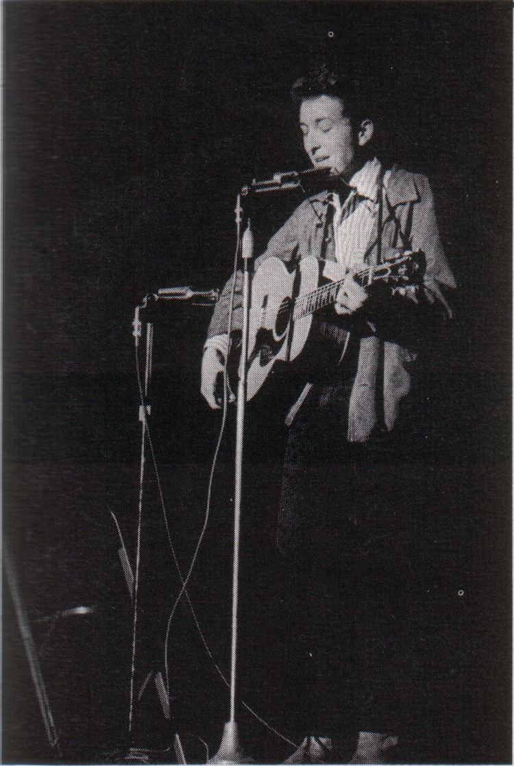 Bob Dylan performing in concert