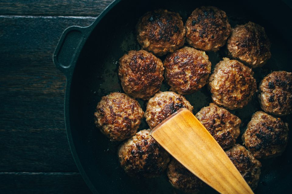 Oven baked meatballs in a cast-iron pan
