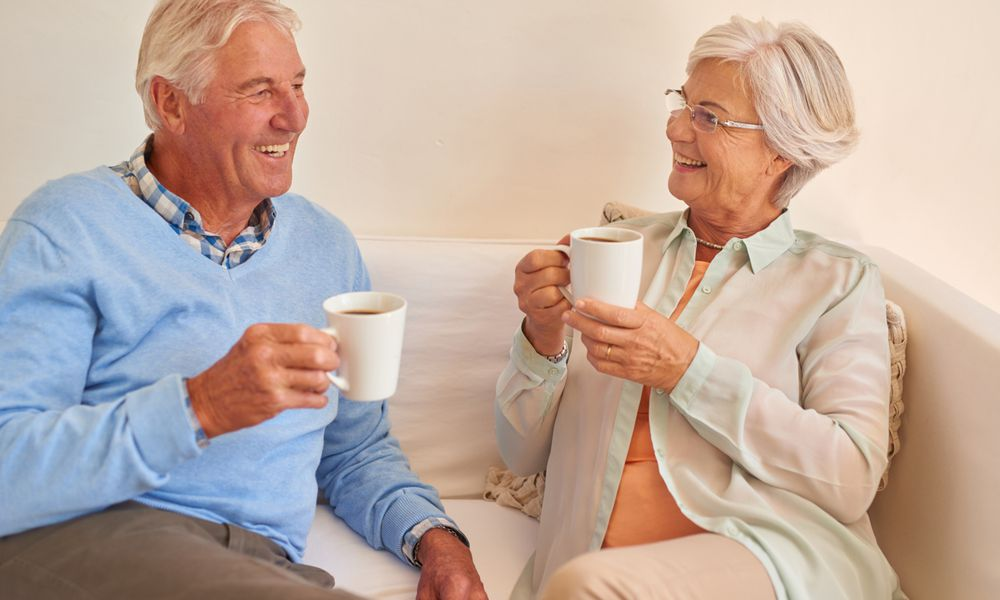 A senior couple drinking coffee together.