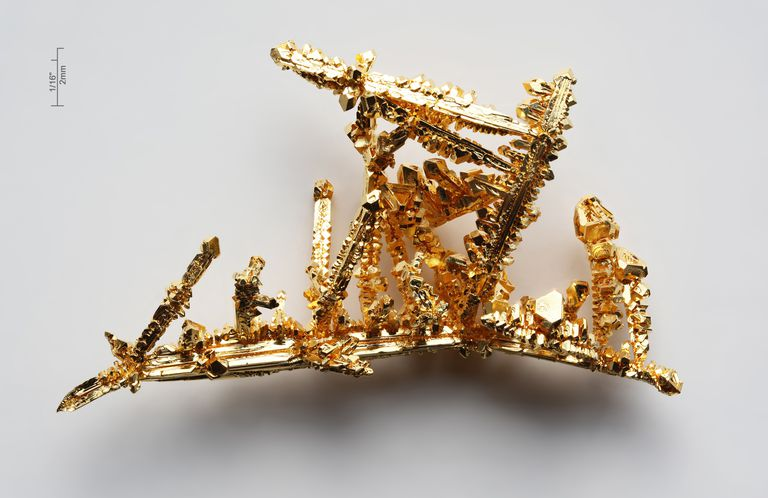 These are crystals of pure gold metal, a well-known precious metal.