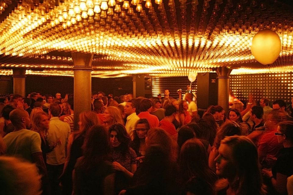 Young people mingle at Jimmy Woo's night club, Amsterdam, Holland.