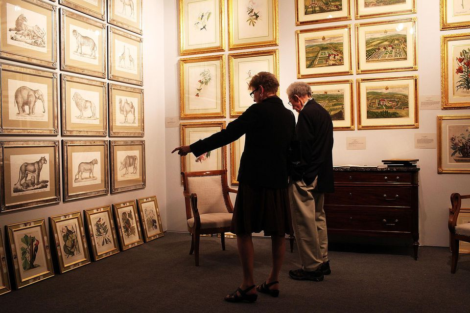 Shoppers Examine Antique Prints at Avenue Antiques & Art at The Armory