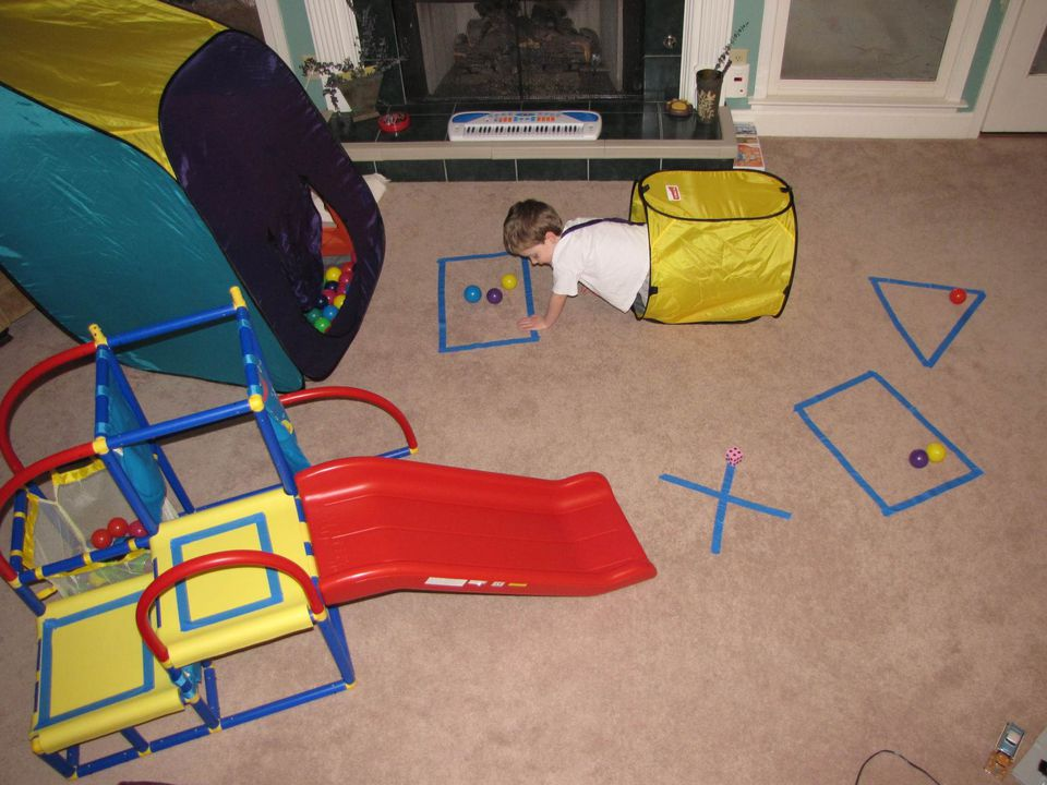 A picture of a child playing a life-sized board game