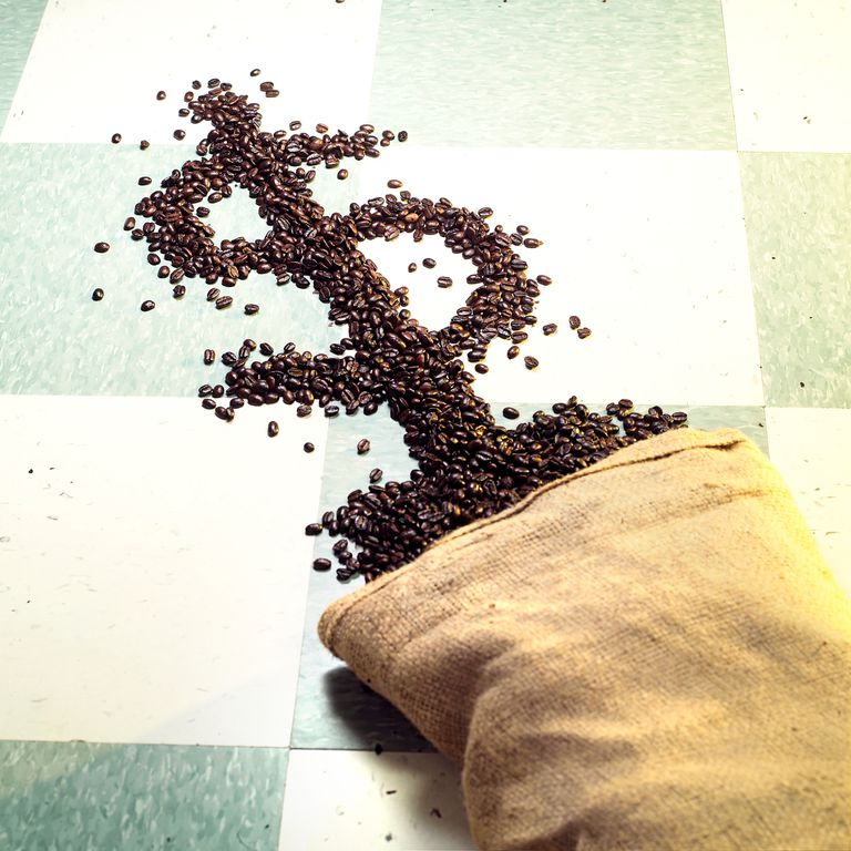 Roasted coffee beans forming dollar sign