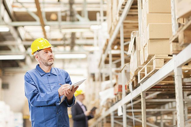 Man checking stock in warehouse