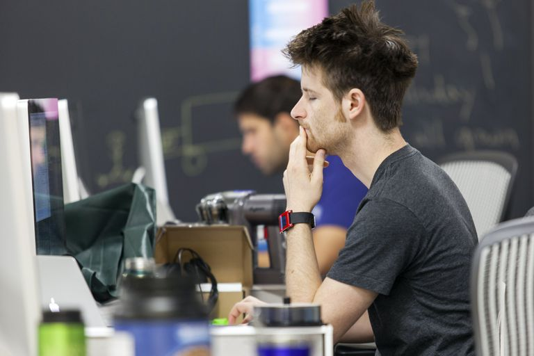 Young white male in front of a computer screen
