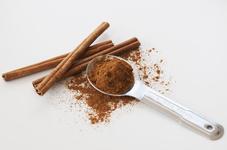 Studio shot of cinnamon stick and cinnamon powder