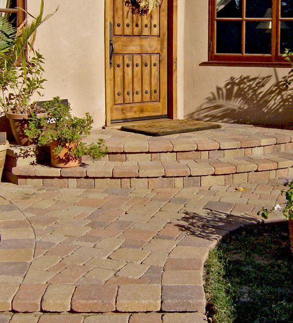 Tuscan House Style With Front Walkway And Italian Cypress: Ground Cover Between Pavers