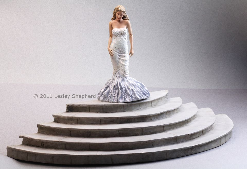 Stone staircase in 1:12 scale made from foamcore board coated with air dry clay.