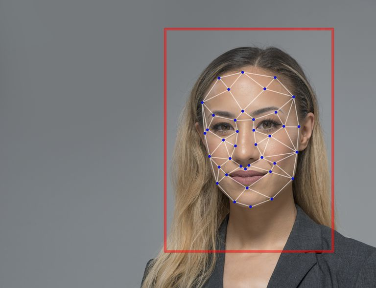 Young woman with facial scan grid mapping her face