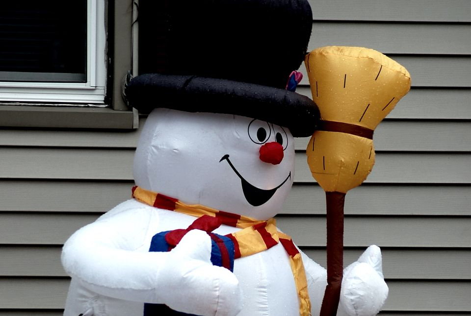 Image: inflatable snowman with broom.