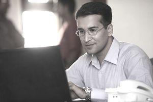 A businessman using a laptop