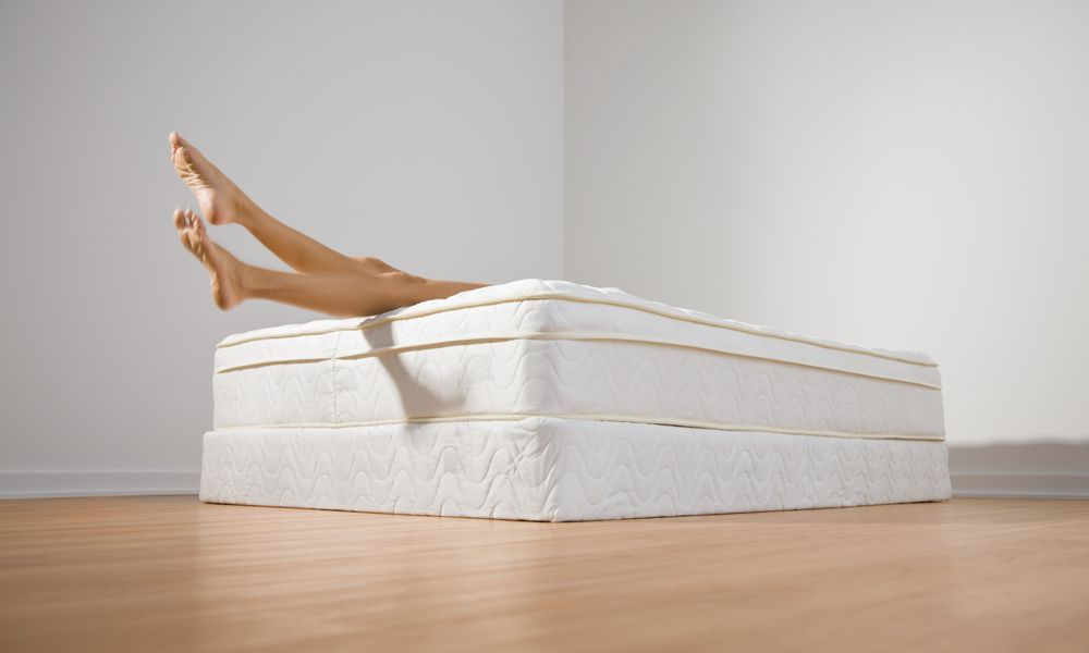 Mattress with a women's legs.
