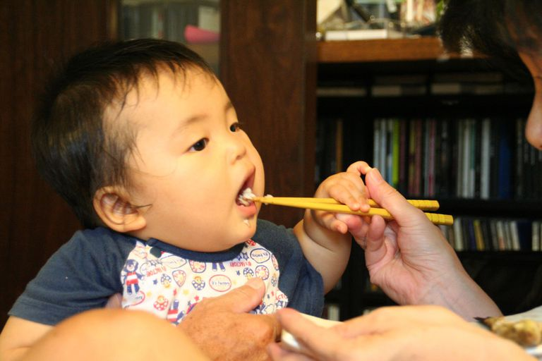 baby eating fish.