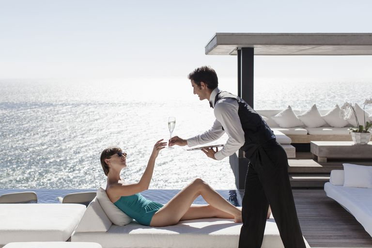 Woman Experiencing Luxury Service at Seaside