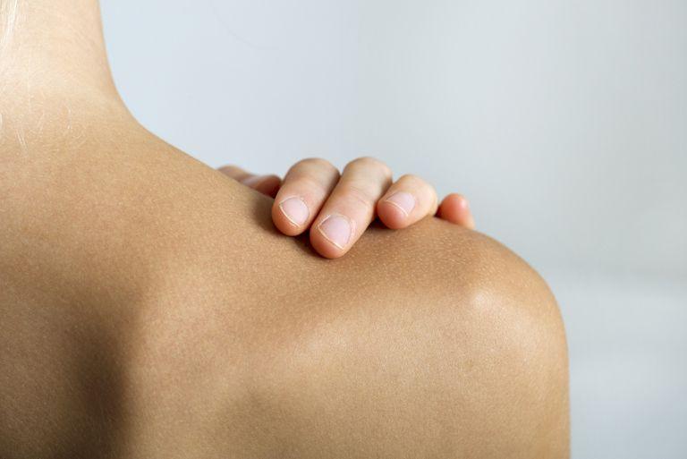 Woman holding shoulder