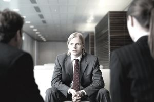 Businessman Having Interview with two people