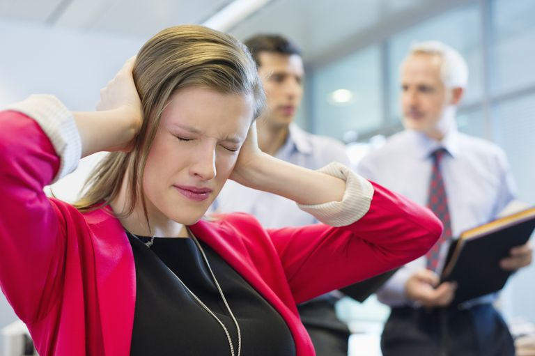 Woman demonstrates frustration and covers her ears